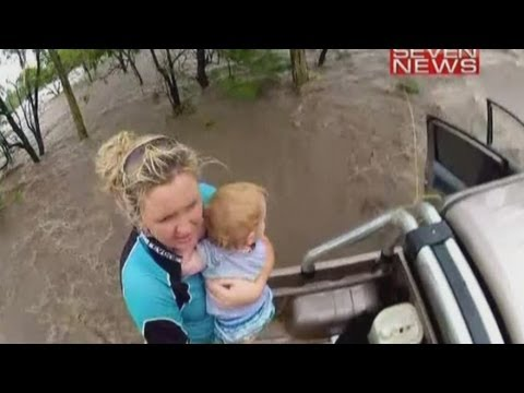 Dramatic flood rescue: Toddler winched from submerged truck in Australia