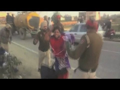 Shocking amateur footage of police beating a woman with sticks in India