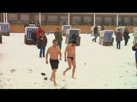 It's freezing! Brave swimmers take plunge in ice cold lake in Berlin