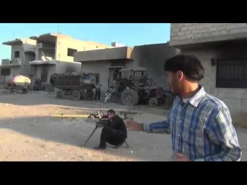 Dramatic amateur video showing Syrian rebels attacking government forces in Homs