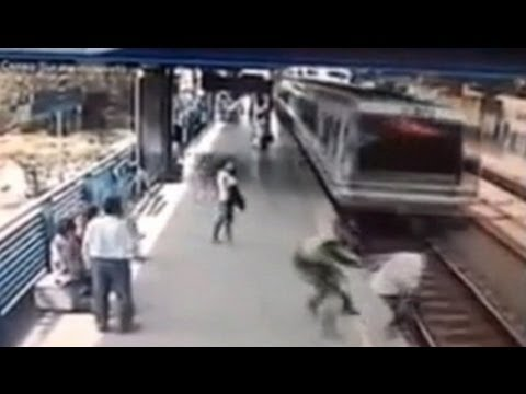 Cop's Last-Second Grab Saves Man from Speeding Train – Caught on Tape