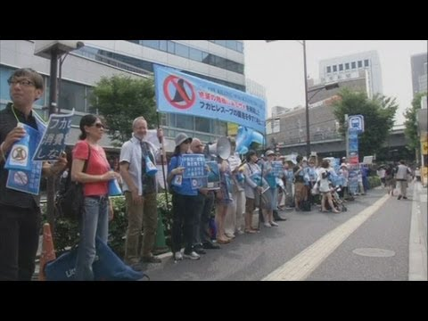 Japanese protesters demonstrate against the sale of shark fin soup