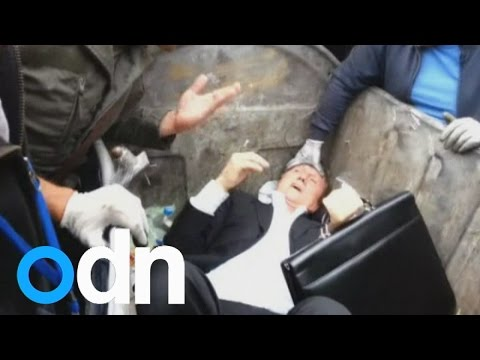 Angry mob throw Ukrainian MP into rubbish bin