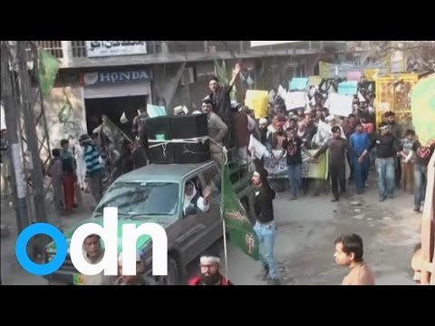 Protestors in Pakistan burn flags and demand beheadings