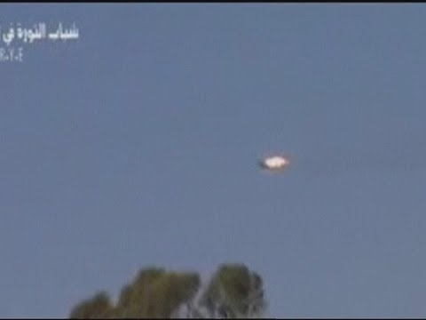 Amateur video: Rebels claim army fighter jet shot down over Syria