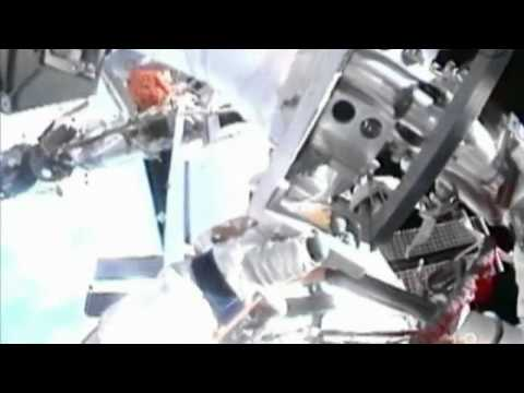 Cosmonauts spacewalk outside the International Space Station
