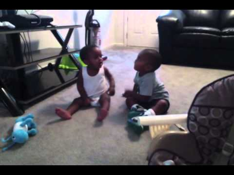 2 funny babies fighting