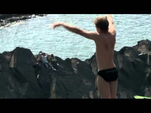 Daredevils competing at Red Bull cliff diving series at Blue Lagoon, Wales