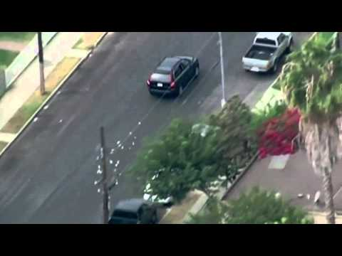 Bank robbers throw cash from car during police chase in LA