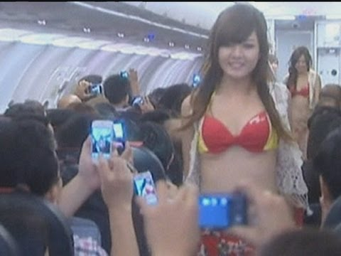 Airline fined after bikini-clad beauty queens dance in aisle