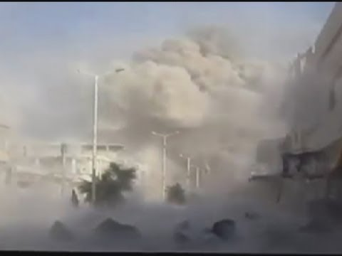 Syria amateur video: Bomb explodes just metres from camera near Homs