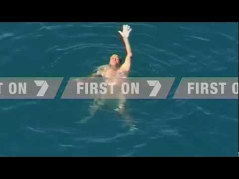 Naked fisherman saved from shark-infested waters in Australia