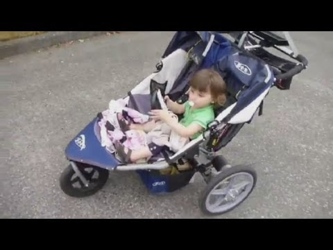Remote controlled buggy driven by toddler passenger