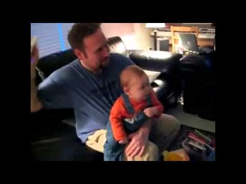 Funny Baby Watching TV with Dad