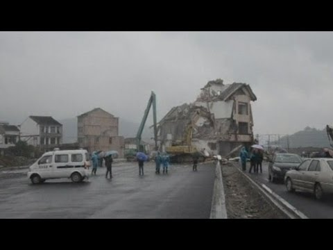 Chinese house in middle of road demolished