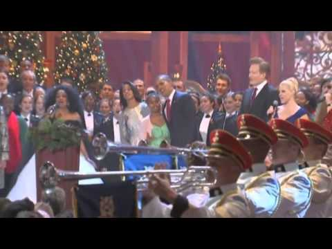 President Obama is joined by Psy and Diana Ross at a charity Christmas concert