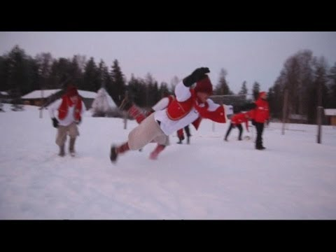 Elves from FC Santa Claus play football in the Arctic snow