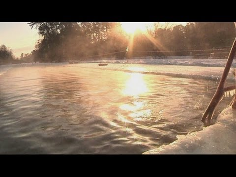 Russian swimmers swim outdoors in -20C temperatures